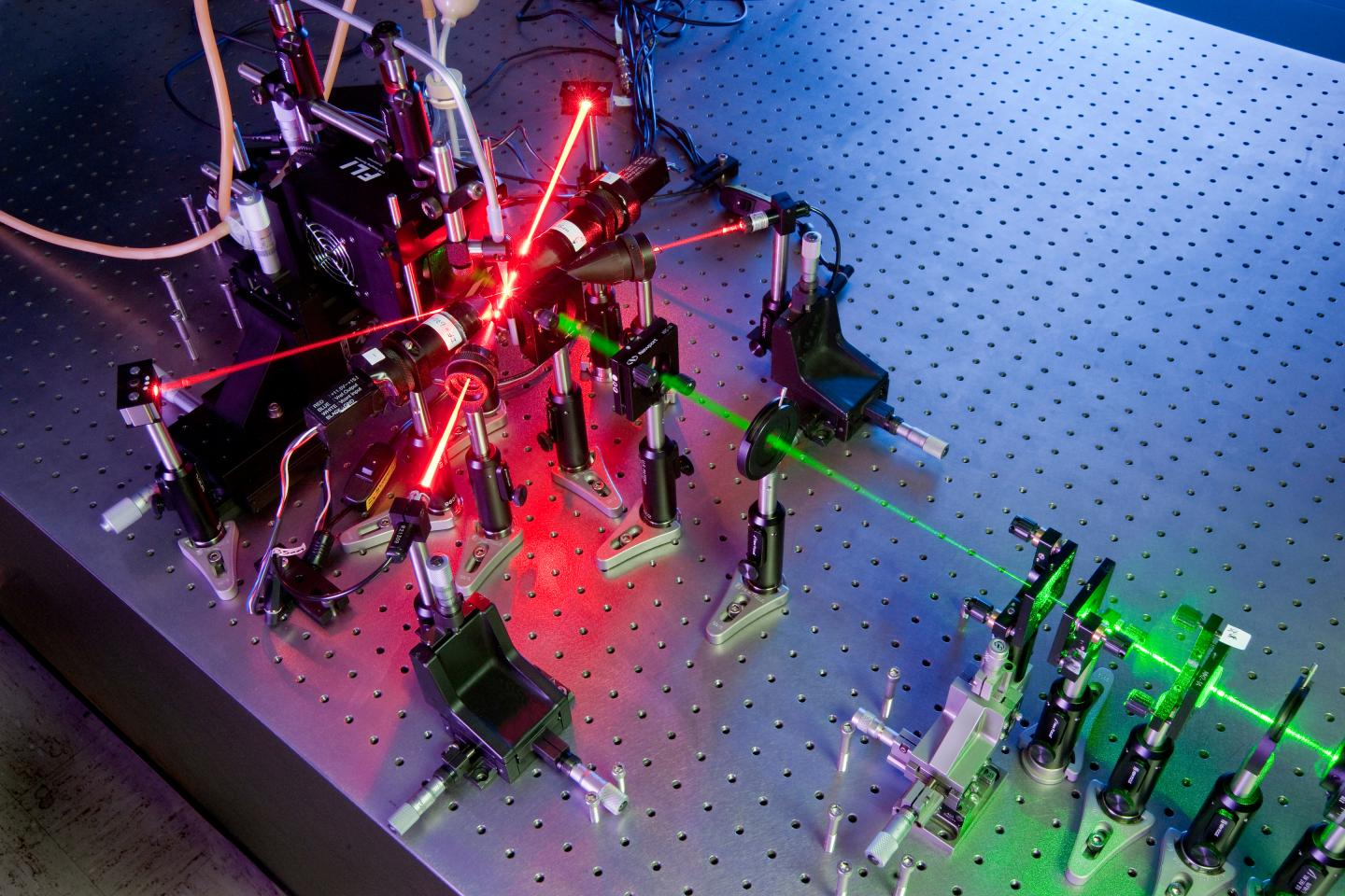 Two overlapping lasers are helping Kansas State University physics researchers create holographic images of free-flowing air particles, which may help climate scientists and biological weapons watchdogs monitor what's in the air. (Kansas State University)