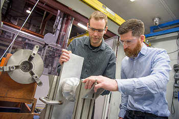 Preparing a prototype part for an electric motor in the NRC's cold spray facility. Source: NRC
