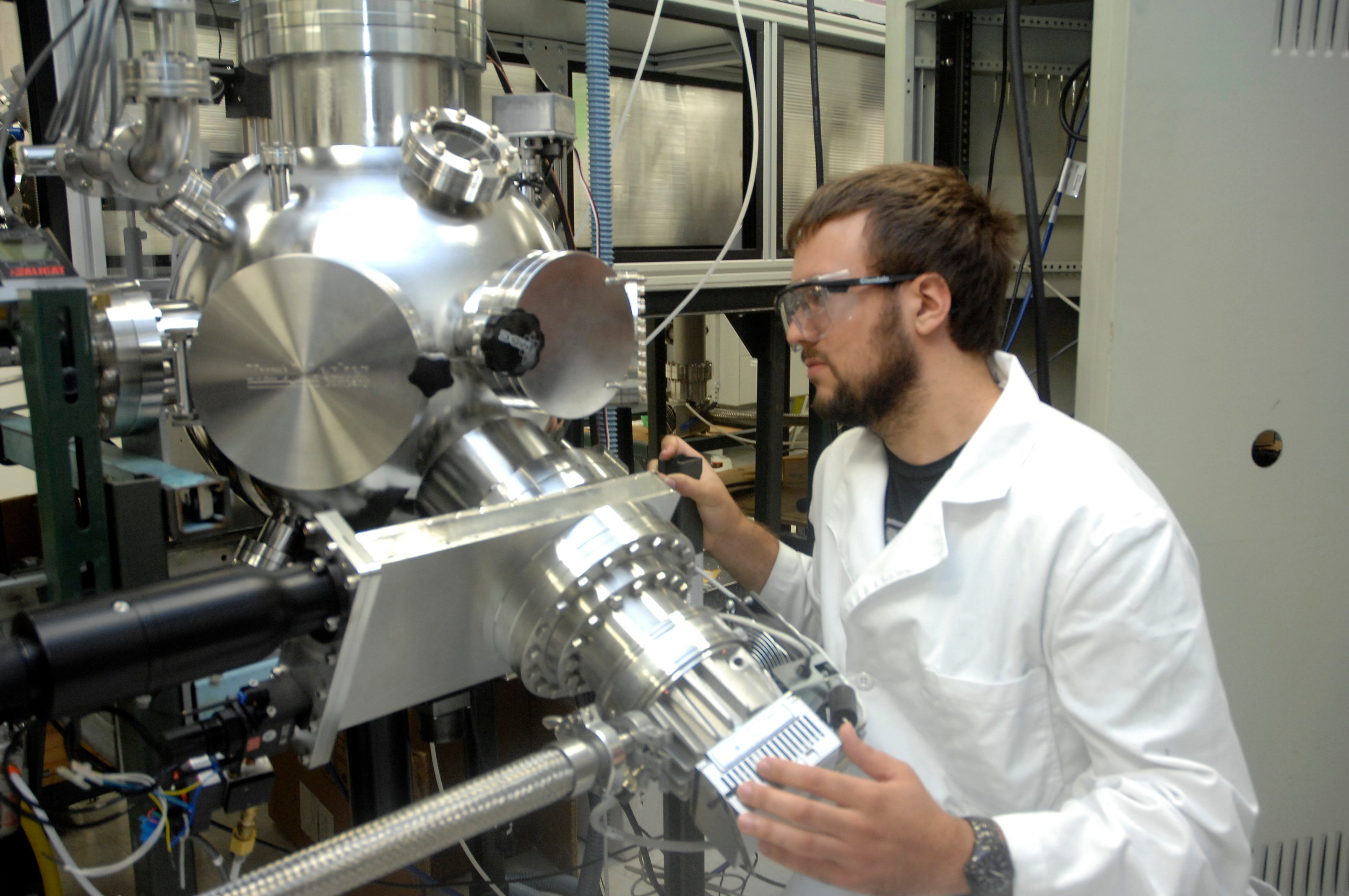 Benjamin Pierce, a research scientist in the Superconductor Pulsed Laser Deposition Lab (Air Force photo by Al Bright)