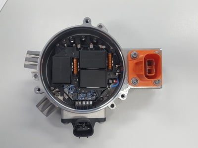 Figure 1: AB Mikroelektronik GmbH chose CeraLink for its automotive, high-voltage, electronic water pump. Three CeraLink SP modules result in a compact 60 µF DC-link capacitor. Source: TDK Electronics AG