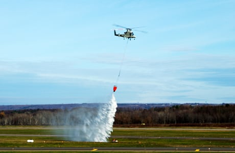 The Stalker UAS directs the unmanned K-MAX cargo helicopter to conduct water drops at a precise location to extinguish a fire. Image credit: Lockheed Martin.