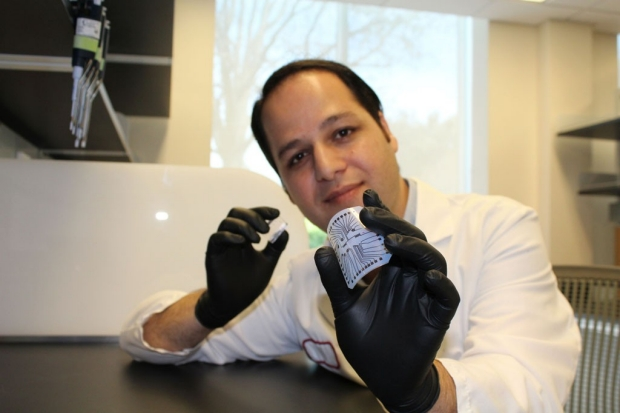 Dr. Rahim Esfandyarpour and the biochip he helped create for just a penny. Credit: Zahra Koochak/Stanford