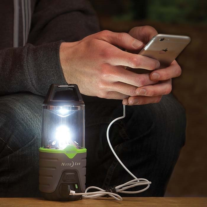 The Radiant 300 Rechargeable Lantern comes equipped with two USB ports that can charge handheld devices and notifies users when its lithium-ion battery needs a recharge. Source: Nite Ize