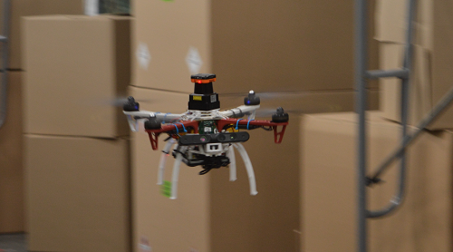 A drone flying through a warehouse using NanoMap. Source: MIT CSAIL