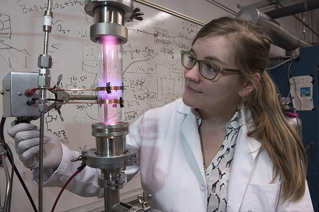 University of Minnesota researcher Samantha Ehrenberg uses a plasma reactor to create silicon nanoparticles. / Photo credit: Uwe Kortshagen, College of Science and Engineering