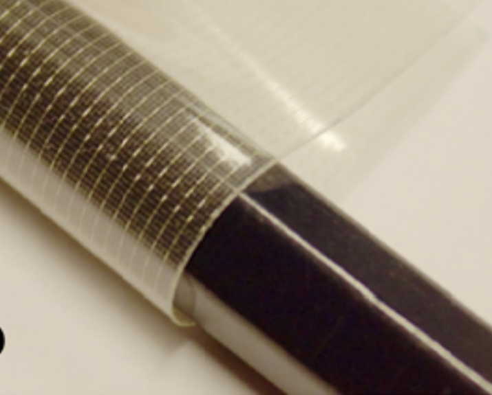 Photograph of the fabric-based electrode, demonstrating its flexibility by being wrapped around a pencil. (Image Credit: Lanz et al./2016 IOP Publishing Ltd.)