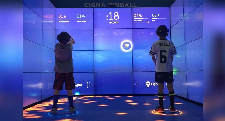 An interactive game allows players to learn their blood pressure and body mass index and receive the results privately through their headsets. Source: Cigna