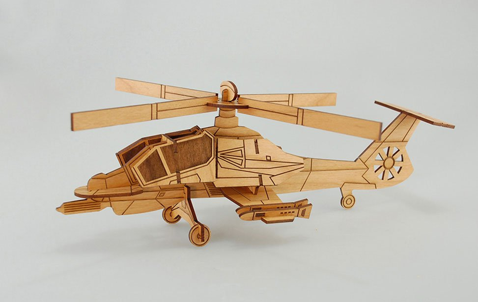 A wooden helicopter model engraved with an Epilog Laser.