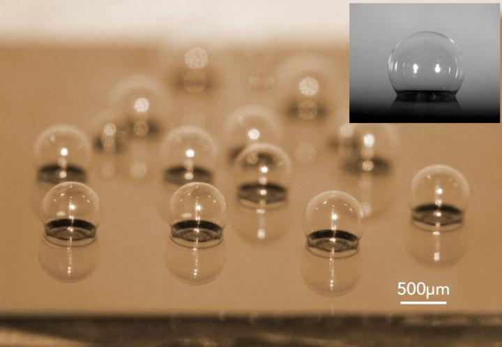 This is a chip-scale glass microspherical shell sensor array blown on a silicon substrate. Insert is a near-perfect spherical shell. Source: Tadigadapa Lab/Penn State