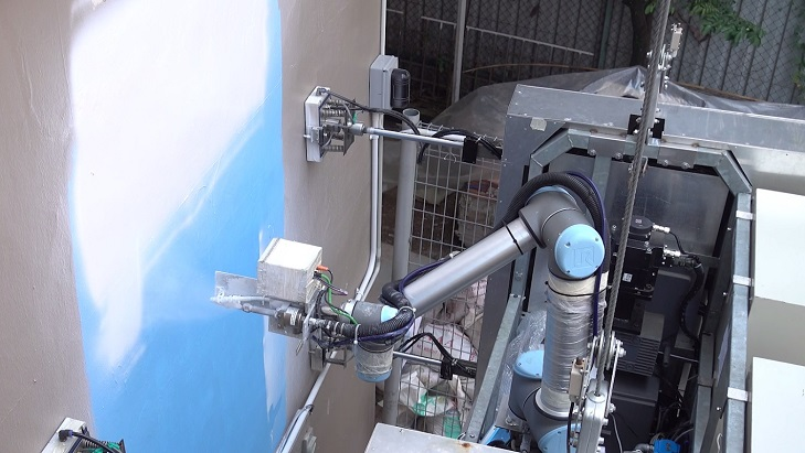 Robotic system uses camera and jets to precisely spray water or paint on building facades. Credit: NTU