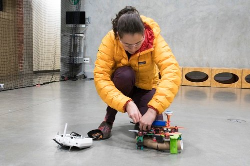 An engineering student programs and builds a drone in the Lentink lab. Source: Stanford University