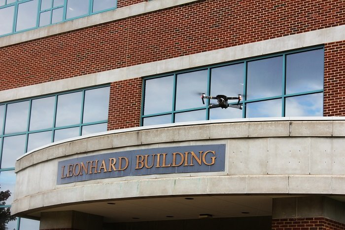 The researchers' drone shown hovering above Penn State's Leonhard Building.