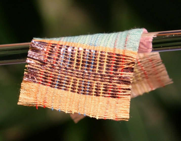 A piece of fabric was woven with special strands of material that harvest electricity from the sun and motion. (Image Credit: Georgia Tech)