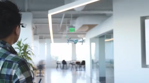 A new AR flight simulator app allows a user wearing Epson's Moverio smart glasses to fly a virtual 3D drone in the real world. Source: Epson Moverio