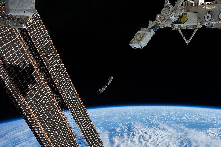 CubeSats being launched by a Japanese robotic arm. (Image Credit: NASA)