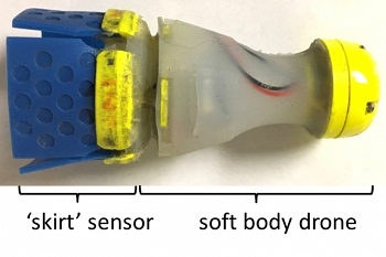 Small variations in pressure are detected by sensing the pull at the edges of its soft rubber skirt, which fills the diameter of the pipe. Image credit: MIT PipeGuard team