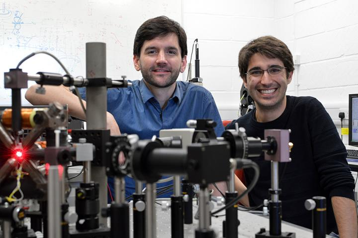 Amalio Fernández-Pacheco, principal investigator of the project (left) and Dédalo Sanz-Hernández, lead autor of the work, (right) posing with the optical system used to read information from 3D magnetic nanostructures. Source: Dédalo Sanz-Hernández