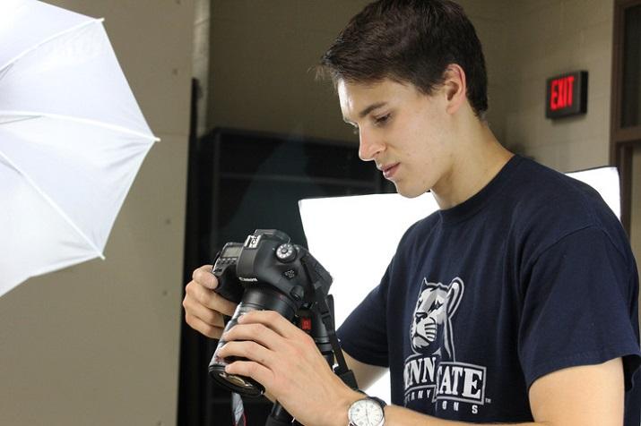 Andrew Bellows, a graduate student in mechanical engineering, takes photos of a bottle opener from different angles in order to generate a point cloud from which the object can be 3-D-printed. (Image Credit: Pamela Krewson Wertz/Penn State)