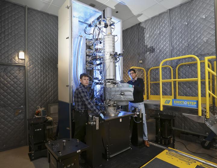 Andrew Lupini and Juan Carlos Idrobo use ORNL's new monochromated, aberration-corrected scanning transmission electron microscope, a Nion HERMES to take the temperatures of materials at the nanoscale. Source: Oak Ridge National Laboratory, US Dept. of Energy