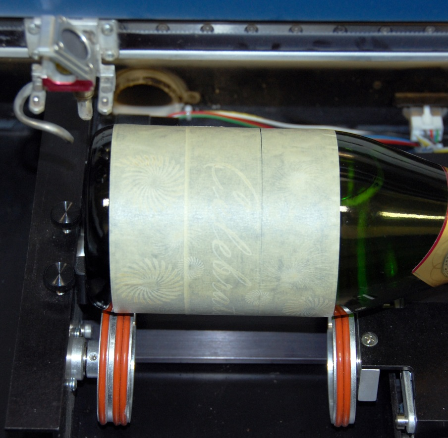 Figure 4: Masking glass with tape helps test the material in advance. (Source: Epilog Laser)
