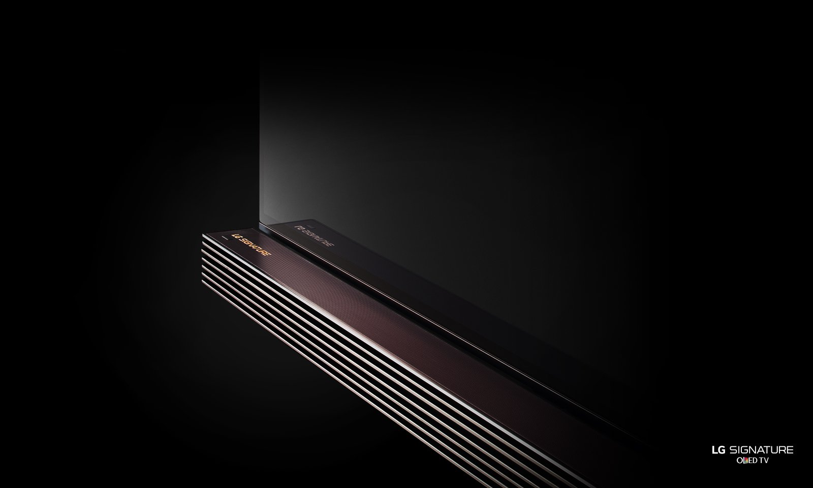 The forward-facing sound bar doubles as a low-profile stand.