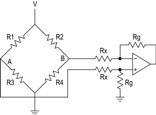 Figure 3. An instrumentation amplifier connected to the original bridge circuit of Figure 1 .