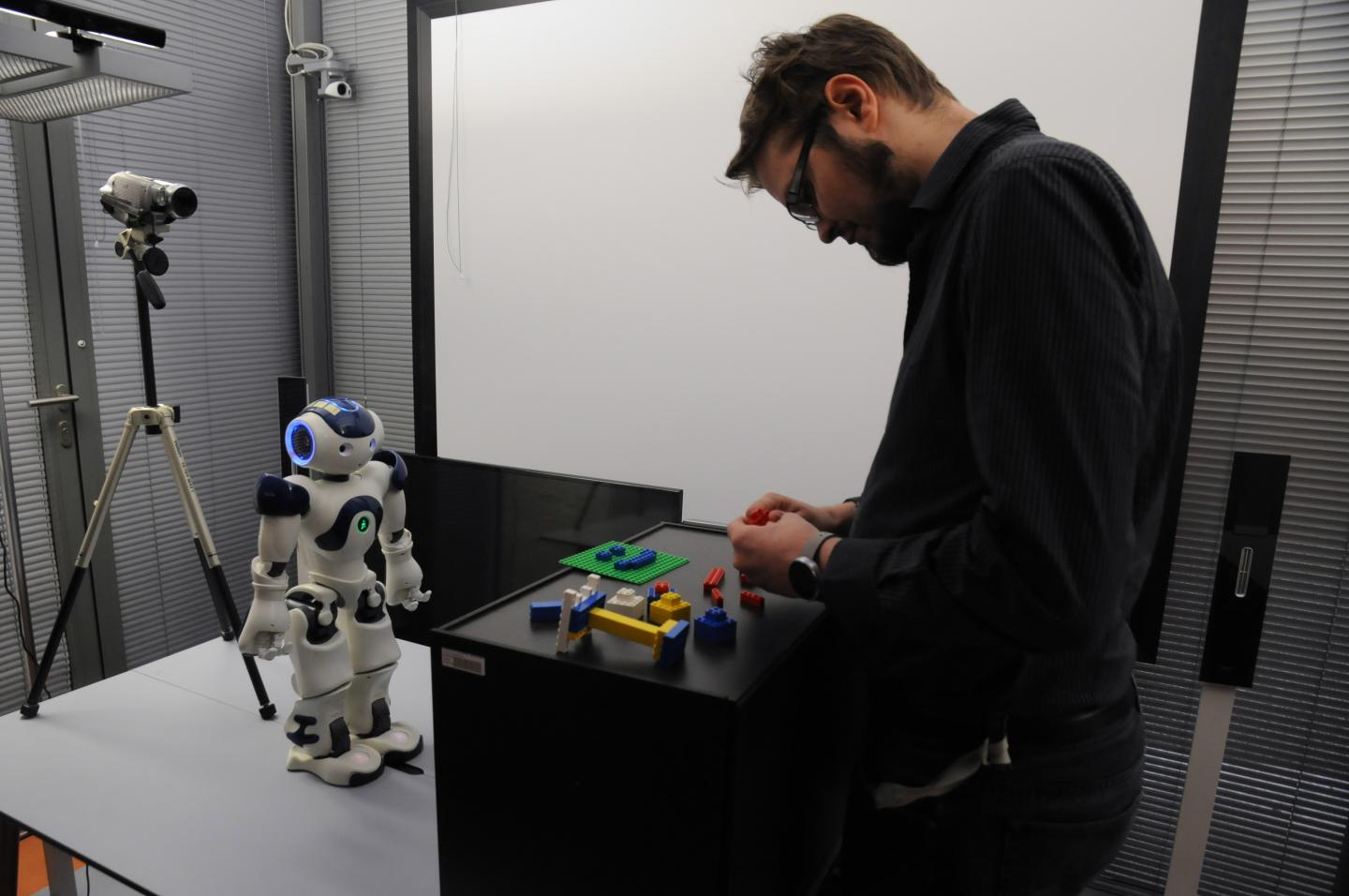 One of the study participants interacting with the robot during the experiment. (Center for Human-Computer Interaction)