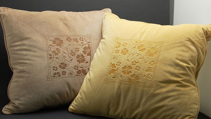 Laser-engraved throw pillows. (Image via Epilog Laser)