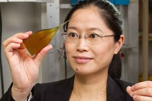 Virginia Tech researcher Xiaoting Jia holds a miniature neural device that records signals from the brain and stimulates neural activity. (Source: Virginia Tech)