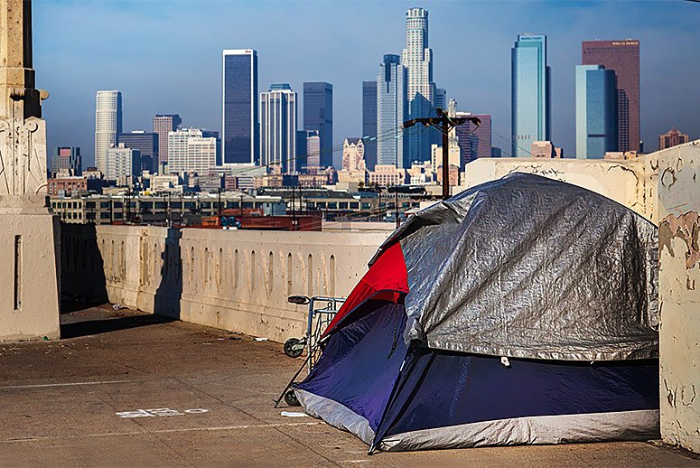 A tent where one of the 44,000 homeless people in Los Angeles County sleeps is within view of the city's financial center. (Source: Getty Images)