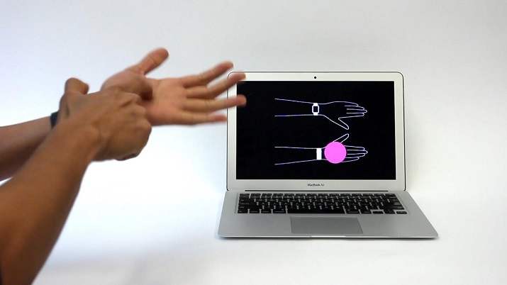 Carnegie Mellon University researchers show off their new technology using a repurposed sensor. (Image Credit: CMU Future Interfaces Group)