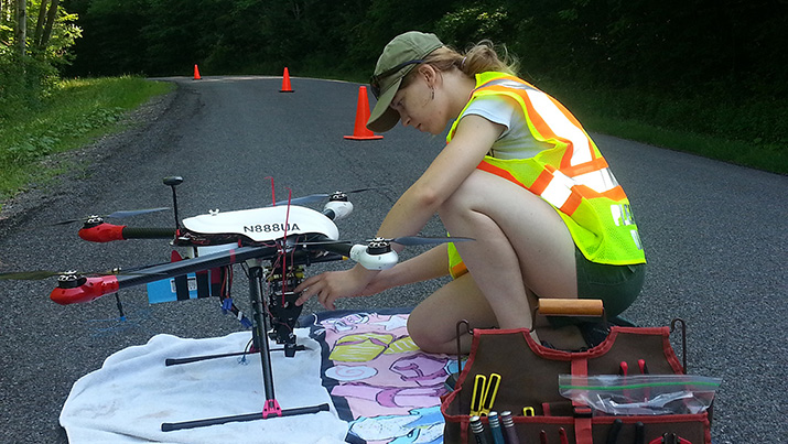 Researcher Charlotte Levy preflighting a drone that will measure surface reactivity. Image credit: Cornell University.