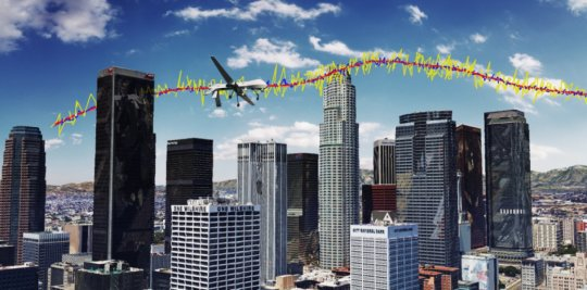 Simulation results for an unmanned drone flying over downtown Los Angeles,  showing the true trajectory (red line), from GPS only (yellow line), and GPS  aided with cellular signals (blue line). Image credit: ASPIN Laboratory at UC Riverside