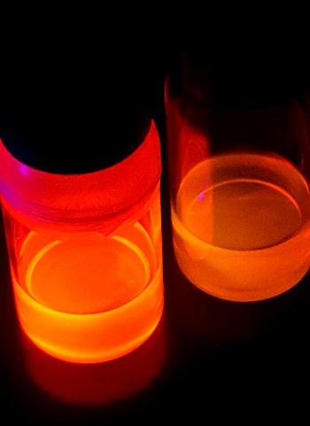 Pure red cadmium-free quantum dots next to standard OLED phosphors on the right. Source: Quantum Materials
