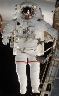 The NASA EMU spacesuit outside of the ISS. Image credit: NASA