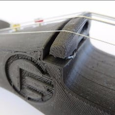 Fig.6 A stringed instrument printed in carbon Fiber PLA. (Image Credit: Proto-Pasta)