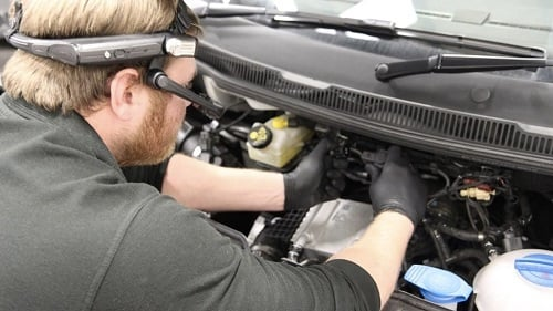 A technician uses the RealWear HTM-1 device to work on a vehicle. Source: RealWear