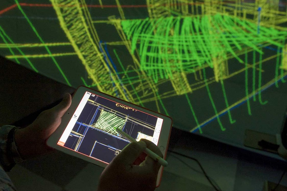 Users can navigate through a virtual 3D environment using a tablet.