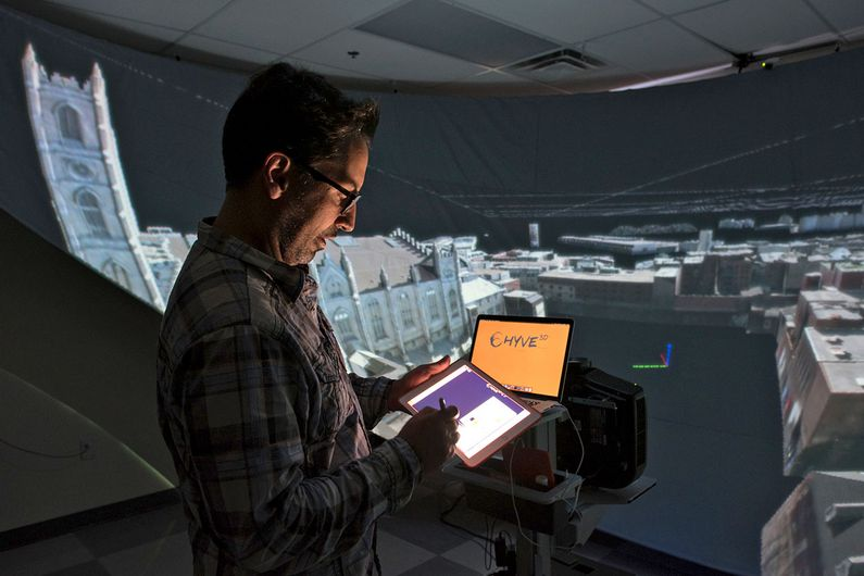 The researcher studies the reactions of viewers in an immersive theater environment.