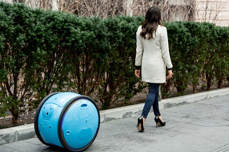 The Gita is a round cargo vehicle that maps its surroundings while following a user, bringing 40 pounds of personal gear along with. Source: Piaggio Fast Forward.