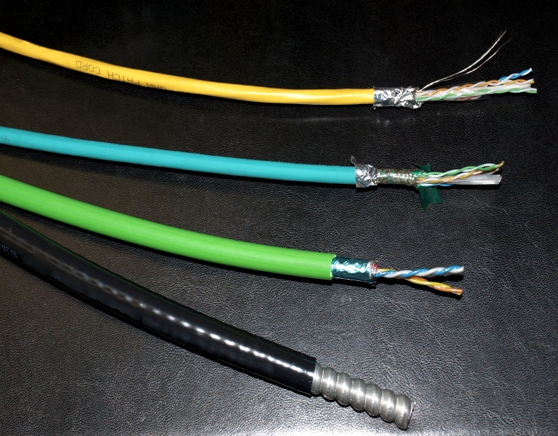 Pictured here are: a typical armored cable (bottom), Quabbin's PLTC-ER cable, a CM-rated Harsh Environment cable, and a CM-rated commercial cable.