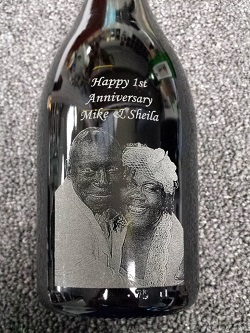 Figure 2: Photographic decoration applied to wine bottle  via laser engraving. (Source: One Stop Awards)