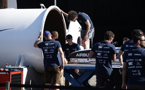 Students from TU Munich load their pod into SpaceX's test track. Source: TU Munich