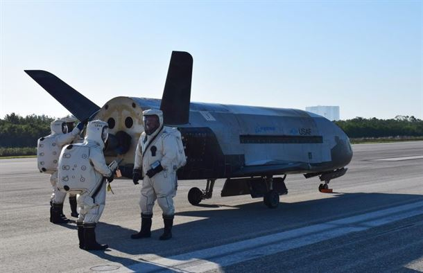 The X-37B under service on the runway.