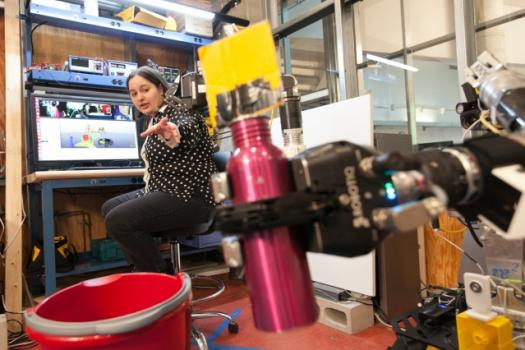 MIT grad student Claudia Pérez-D'Arpino demonstrates the C-LEARN to teach other robots. Image credit: MIT CSAIL