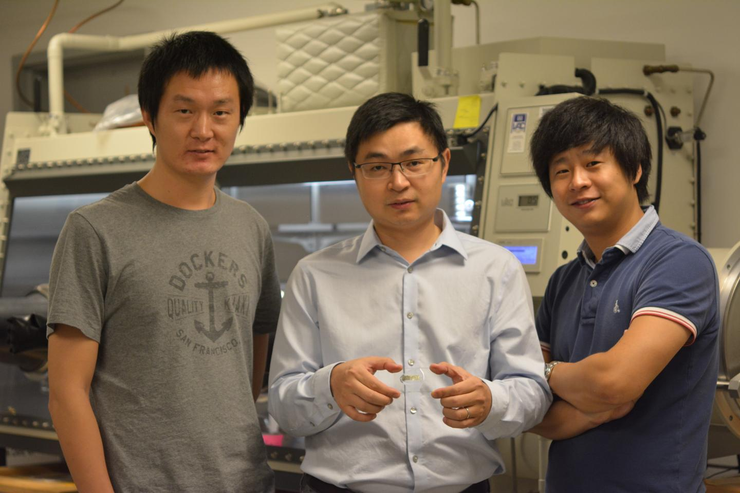 Cunjiang Yu, Bill D. Cook assistant professor of mechanical engineering at the University of Houston, center, and co-first authors Xu Wang, left, and Kyoseung Sim, right (University of Houston)