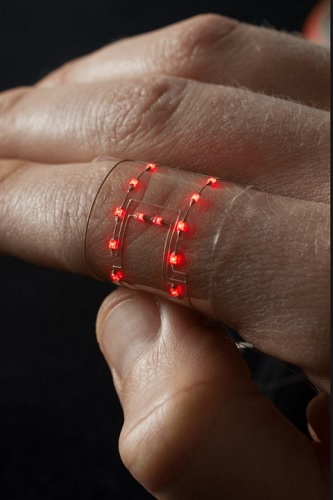 A completed hybrid 3D printed wearable conforms to the curve of the skin. Source: Harvard University