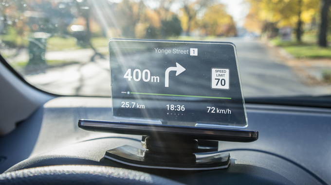 Hudify is a portable heads-up display that works with a smartphone to provide navigation and automotive telematics. Source: Hudify Inc.