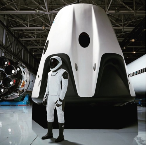 The new SpaceX spacesuit outside the Crew Dragon module. Source: SpaceX