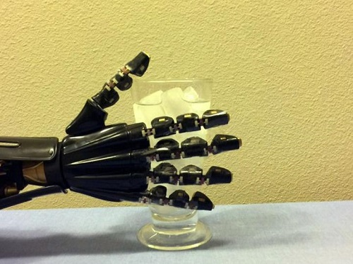 Researchers tested the artificial skin on a robotic hand that could sense temperature. Source: University of Houston